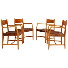 Hans Wegner Set of Four Town Hall Armchairs in Oak and Brown Leather