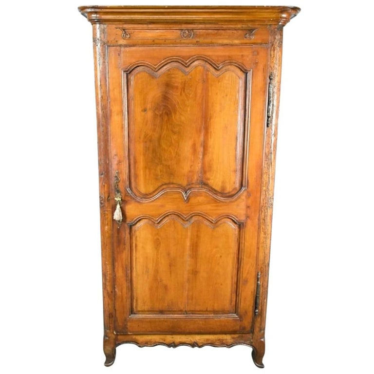 French Provincial Louis XV Fruitwood Bonnetiere, 18th Century For Sale