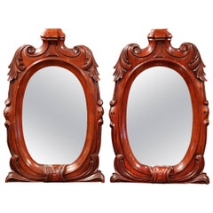 Pair of 19th Century Regency Style Carved Mahogany Mirrors with Foliage Decor