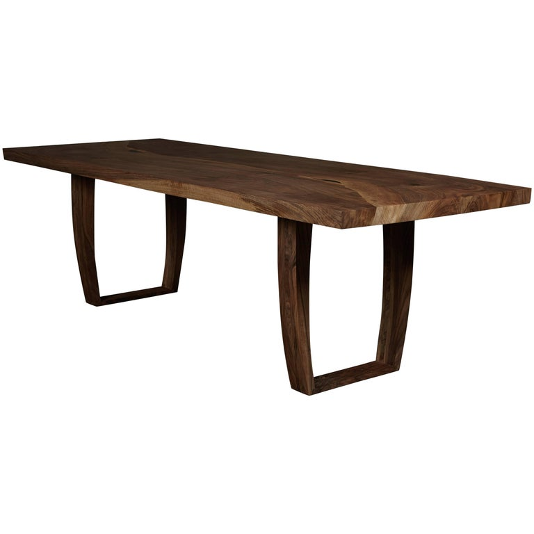 Contemporary ripple walnut dining table with inset live edge by Jonathan Field