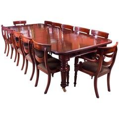 Antique Flame Mahogany Extending Dining Table, circa 1840 and 12 Chairs