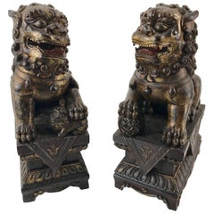 Pair of Chinese Carved Wood and Giltwood Foo Dogs