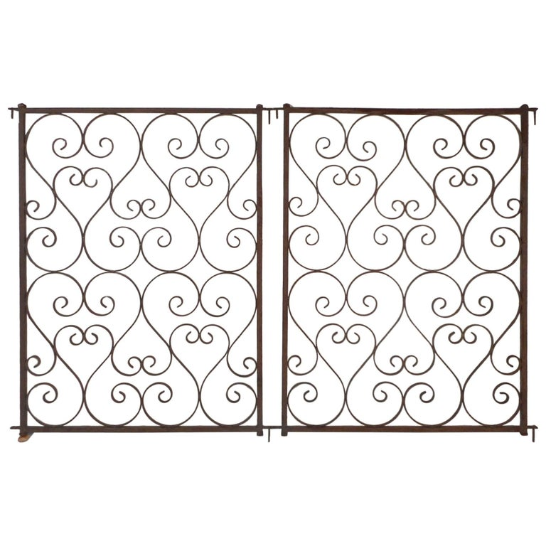 Pair of Vintage Iron Sculpted Gates For Sale