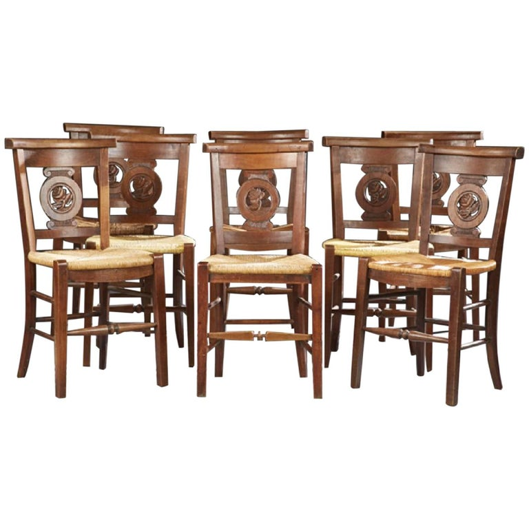 Set of Eight French Provincial Carved Cherry Rush Seat Dining Chairs, circa 1900