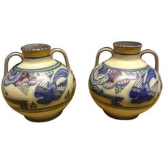 Poole Pottery, a Pair of Vases with Prancing Deer & Colorful Floral Backgrounds