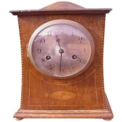 Liberty and Co Attributed an Arts & Crafts Oak Mantle Clock