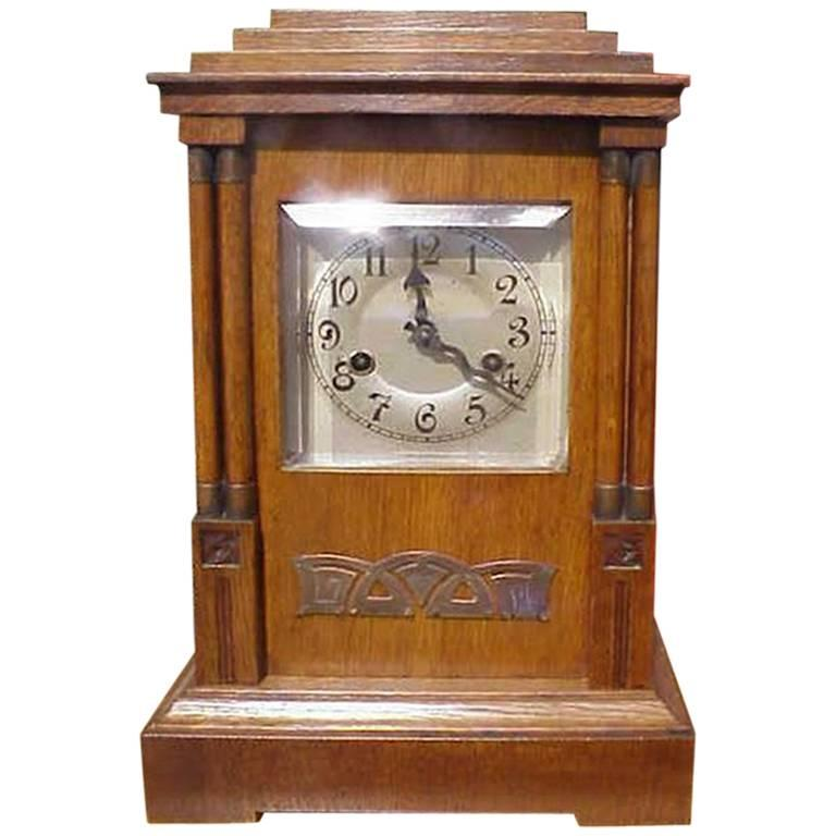 A continental arts and crafts oak mantle clock with carved for Arts and crafts clocks for sale