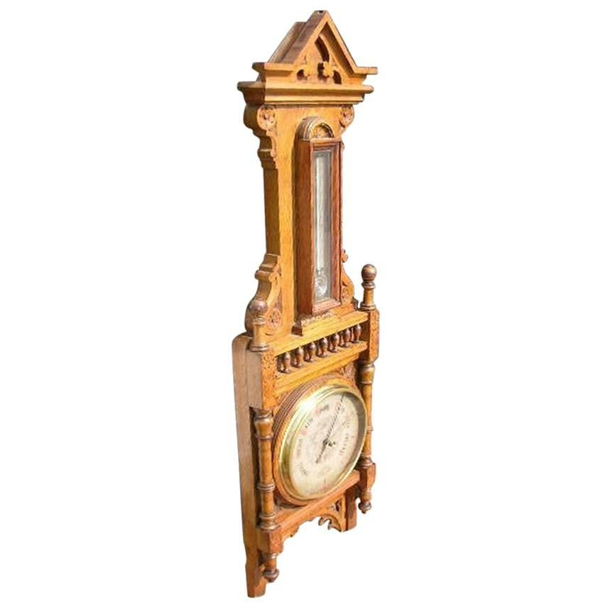 A Large Gothic Revival Carved Oak Barometer with a Rare Snail Tail Thermometer