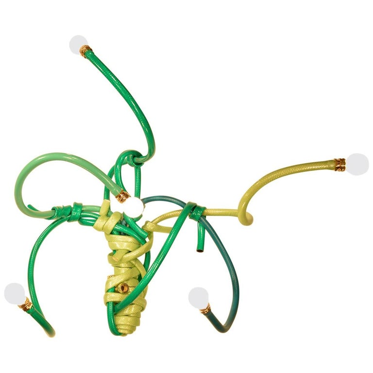 Sconce Style Lighting Fixture Made from Garden Hoses of Varying Shades of Green