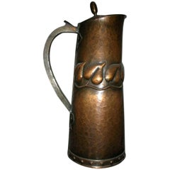 Arts & Crafts Copper Jug with Stylised Repousse Leaf Details