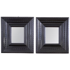 Pair of Late 17th Century Ebony Ripple Moulded Mirrors