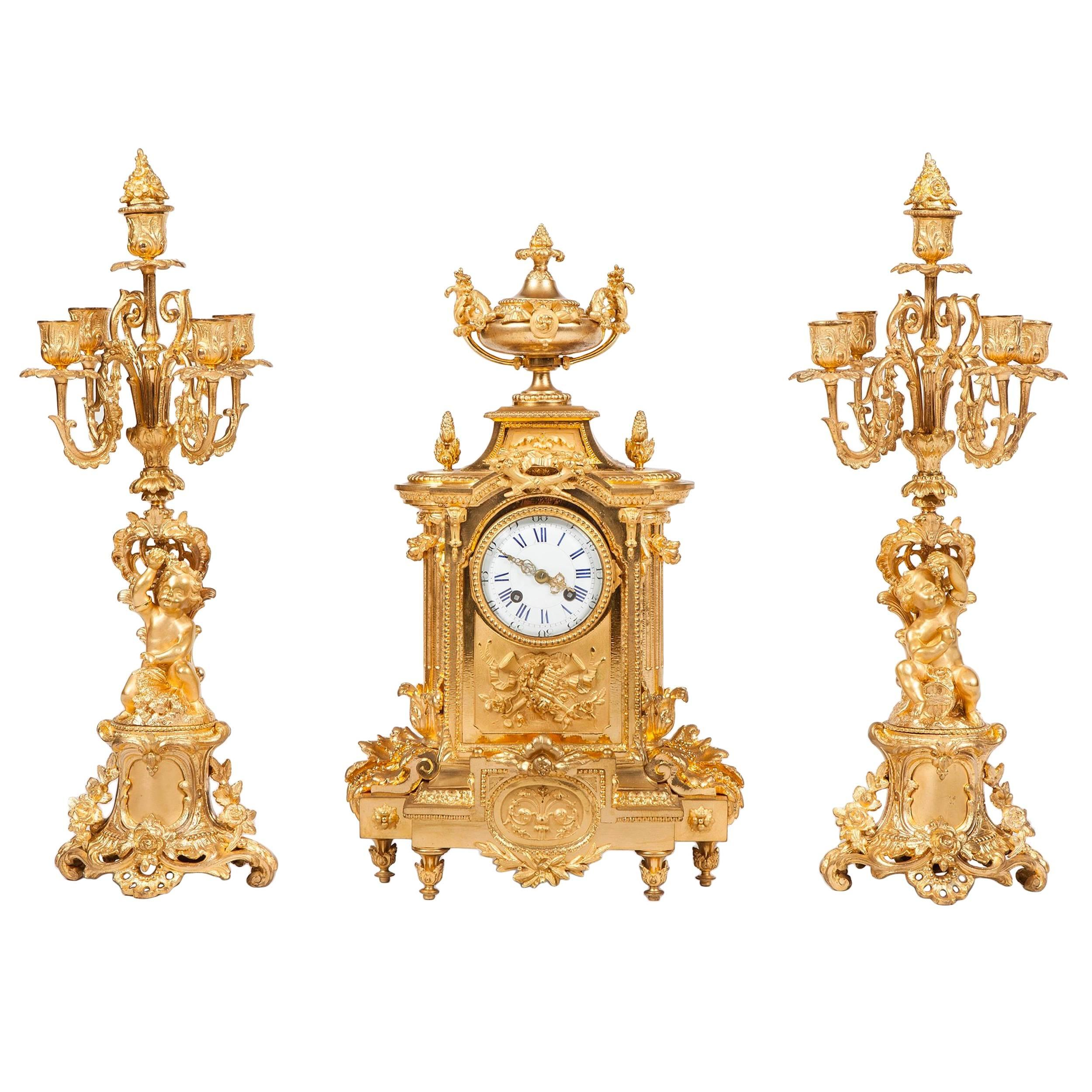French 19th Century Gilt Bronze Mantel Clock and Candelabra