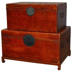 Pair of Chinese Lacquered Leather Covered Trunks on Stand