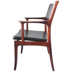 Erik Buch Sculpted Rosewood Armchair for Ørum Møbelfabrik, Denmark, 1958