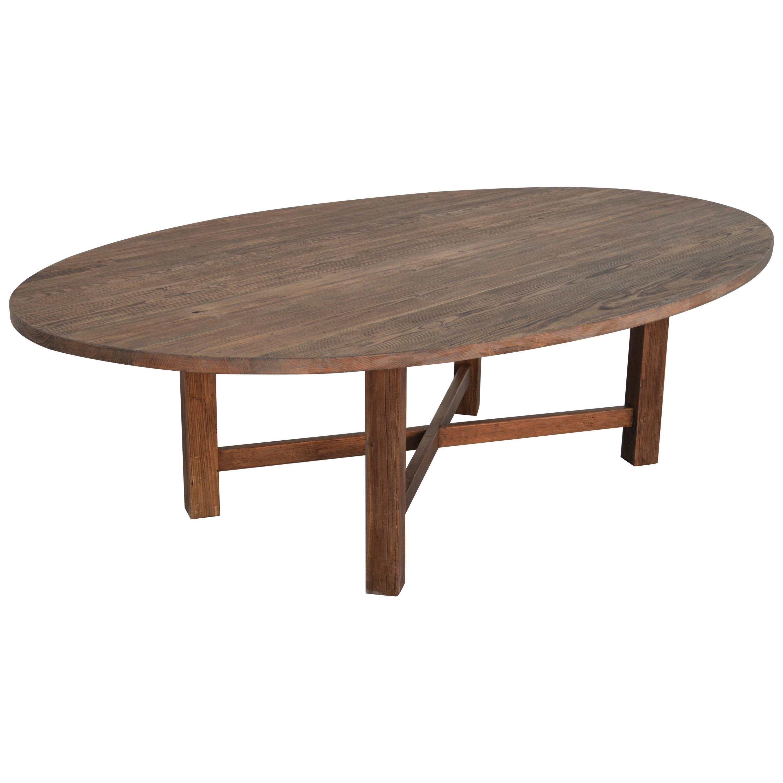 custom built oval dining table in reclaimed heart pine