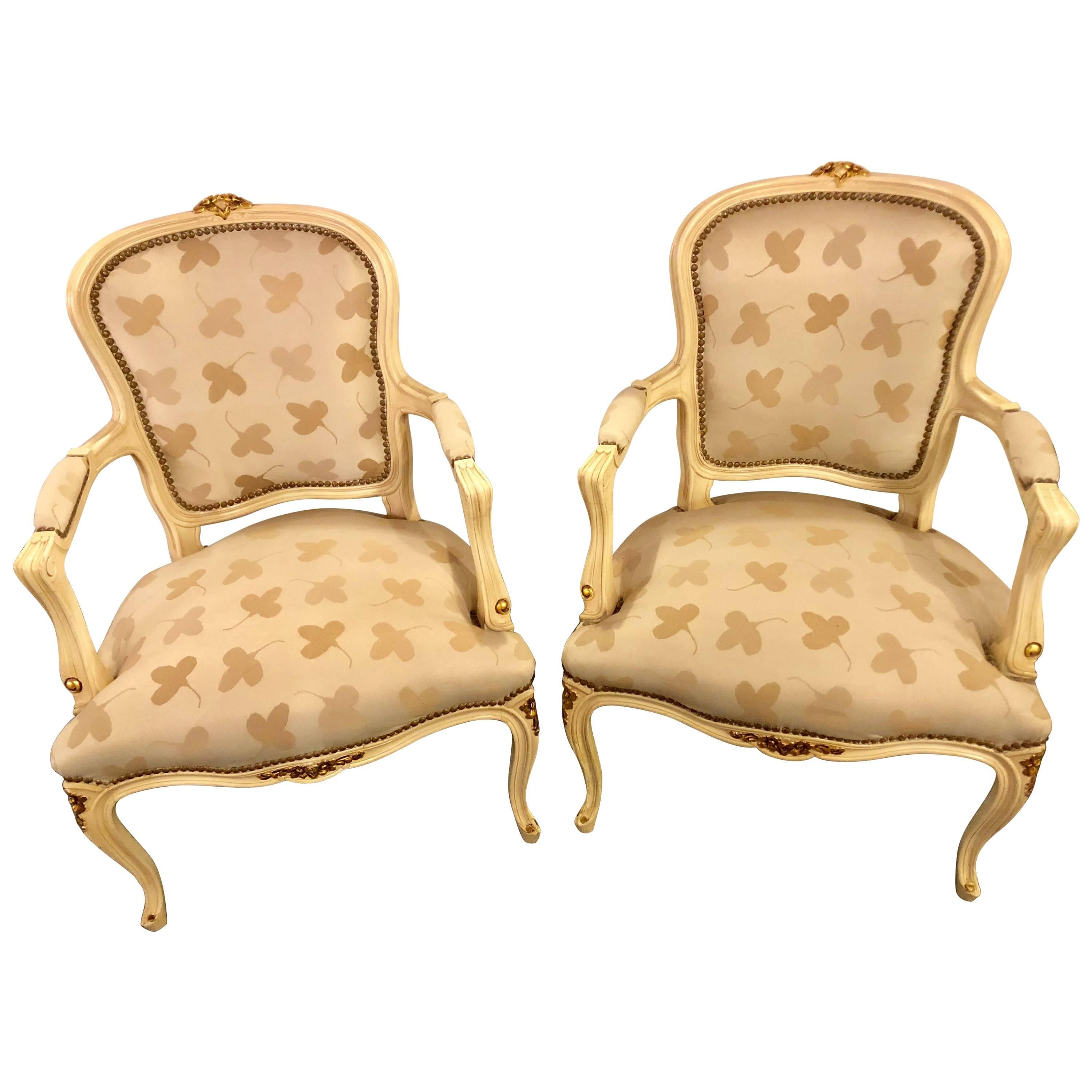 Pair of French Louis XV Style Parcel-Gilt and Paint Decorated Bergere Chairs