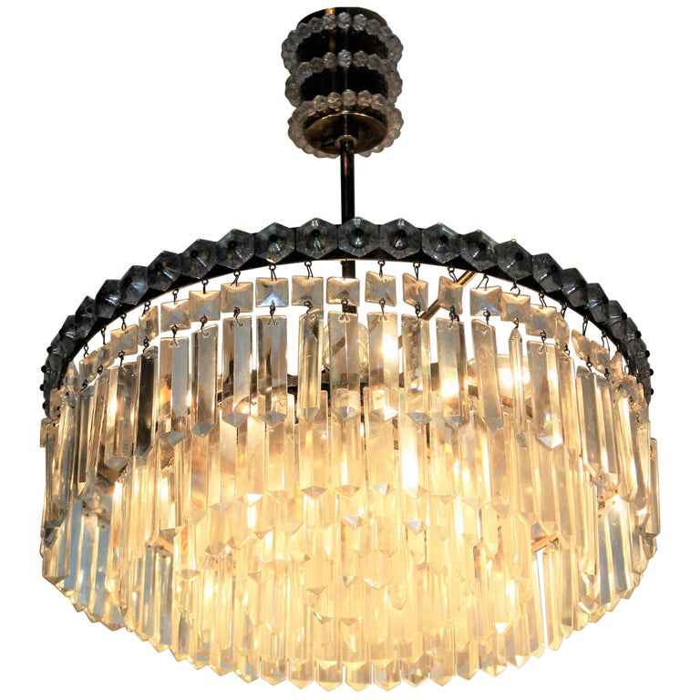 Beautiful, elegant midcentury five-tier glass and brass chandelier, attributed to Bakalowits or Lobmeyr, Austria, circa 1960s. Socket: six x Edison (e14) for standard screw bulbs. Excellent original condition. New rewired for US. Weight: 12,3 Ibs
