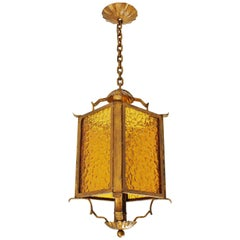 Hand-Hammered Gilt Iron Chinoiserie Lantern with Amber Glass Panels, Spain 1930s