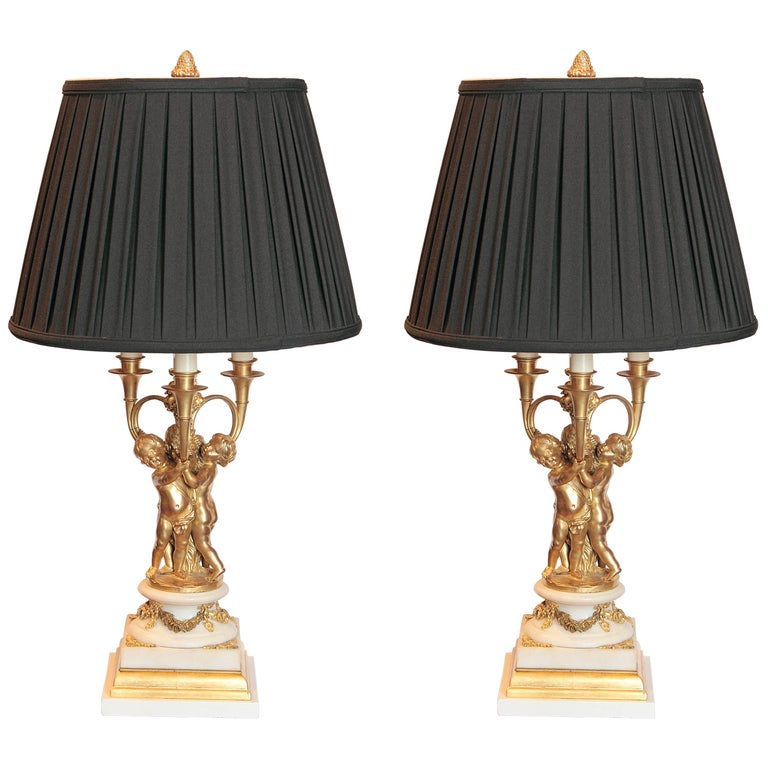 Pair of 19th Century French Gilt Bronze and Marble Based Cherub Lamps