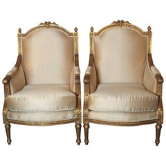 Pair of Late 19th Century French Gilt Carved Louis XVI Bergeres