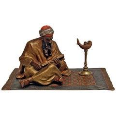Vienna Bergman'n' Bronze Arab Man on Carpet Reading Book Made, circa 1900