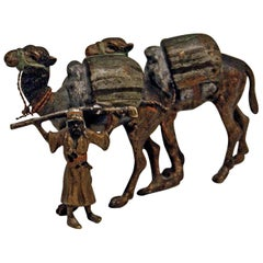Vienna Bergman'n' Bronze En Miniature Arab Man Guiding Camels, circa 1900