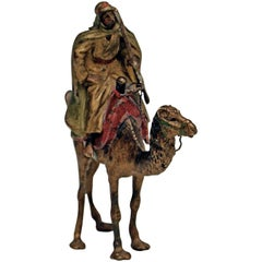 Vienna Bergman'n' Bronze En Miniature Arab Man Riding on Camel, circa 1900