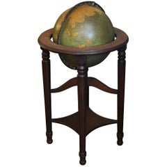 1930s George F. Cram Lighted Standing Glass Library Globe with Mahogany Base