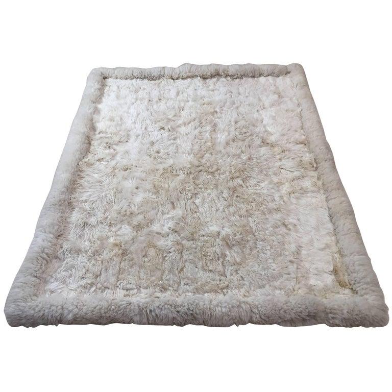 White sheepskin rug, 1950, offered by Mosaik