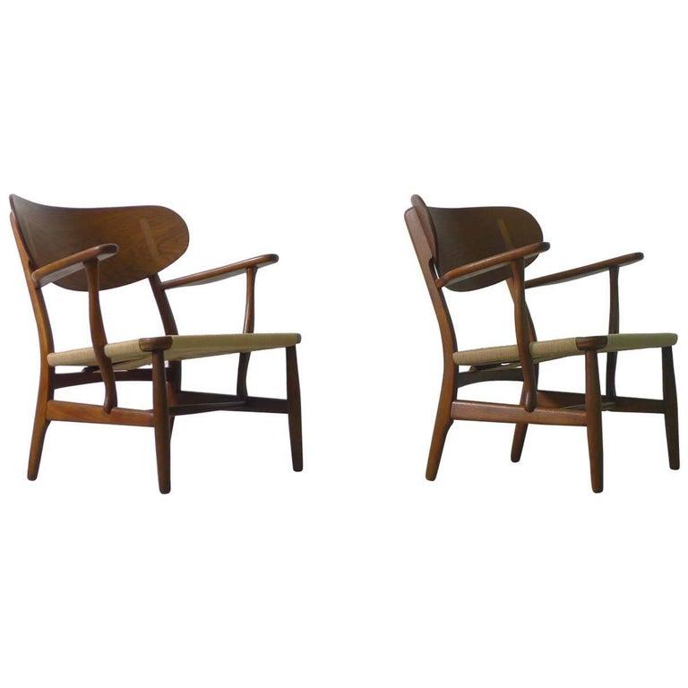 Hans Wegner for Carl Hansen, Denmark, Pair of CH22 Armchairs, 1950s For Sale
