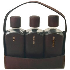 English Leather Wrapped Glass Liquor Bottles and Caddie by Albro, Set of Three