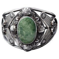 Sterling Cuff with Large Green Centre Turquoise and Elaborated Reliefs, 1940s