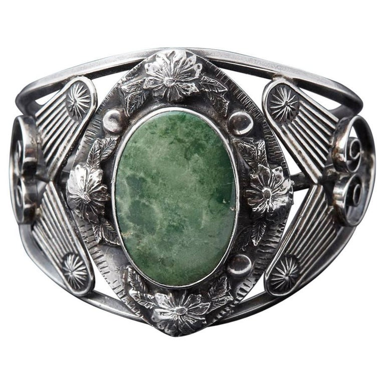 Sterling Cuff with Large Green Centre Turquoise and Elaborated Reliefs, 1940s For Sale