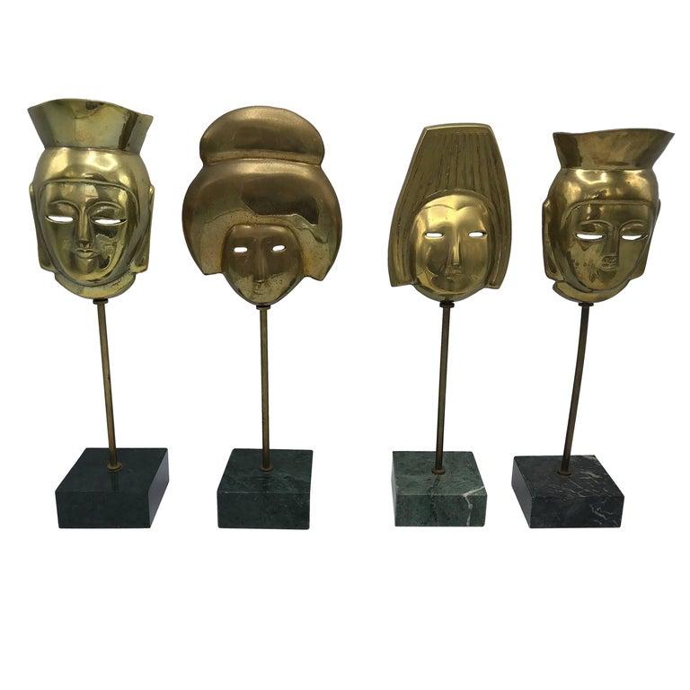 1960s, Italian Modern Brass Asian Mask Sculptures on Marble Base, Set of Four