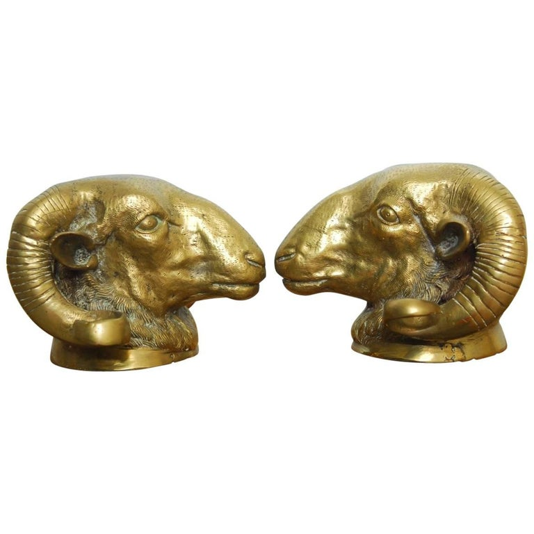 Pair of Patinated Brass Rams Head Sculptures
