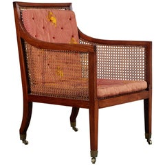 18th Century George III Mahogany Caned Library Chair on Castors