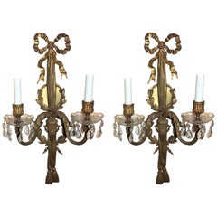 Pair of Bronze Crystal Neoclassical Ram's Head Bow Top Wreath Tassel Sconces
