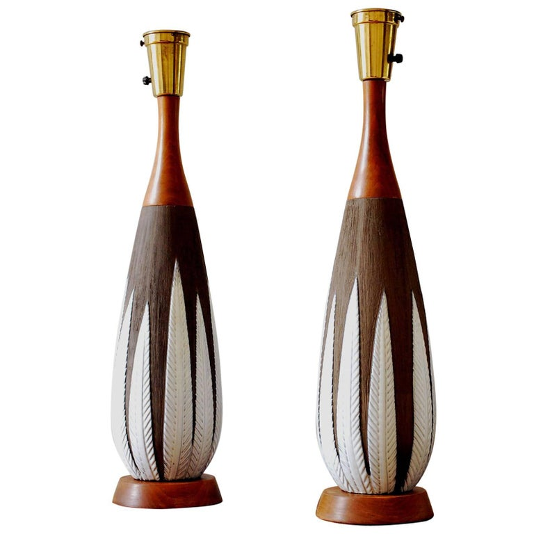 """Pair of Anna Lisa Thompson for Upsala Ekeby """"Paprika"""" ceramic and teak table lamps. Featuring an organic swell form, matte warm brown background and incised leaf pattern in glossy white. Sculptural. Made in Sweden. Rewired with period appropriate"""