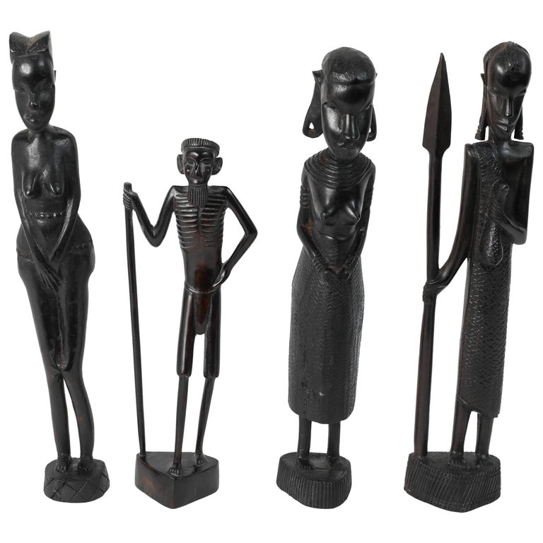 Decorative hand carved african set of four statues from