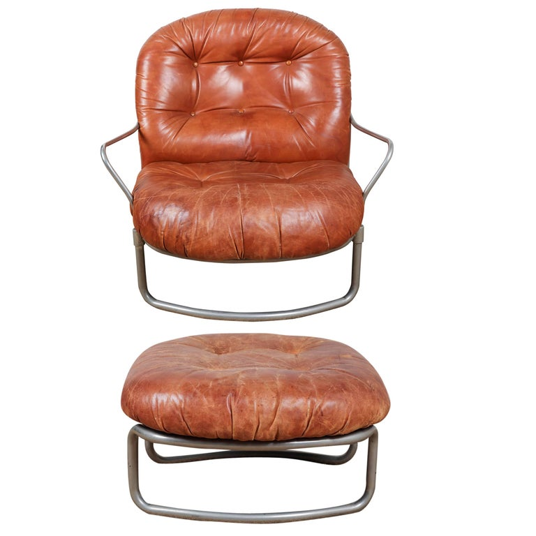 Distressed leather (no rips) and chrome chair and ottoman (25 W x 25 D x 14 H).   Offered by .