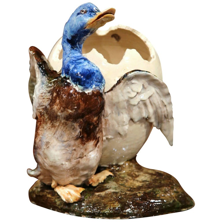 Early 20th Century, French Hand-Painted Barbotine Duck Holding Cracked Egg