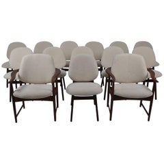 Set of 12 Teak Chairs and Two Armchairs Covered in Sheepskin