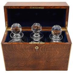Victorian Oak Cased Three Bottle Tantalus, circa 1880