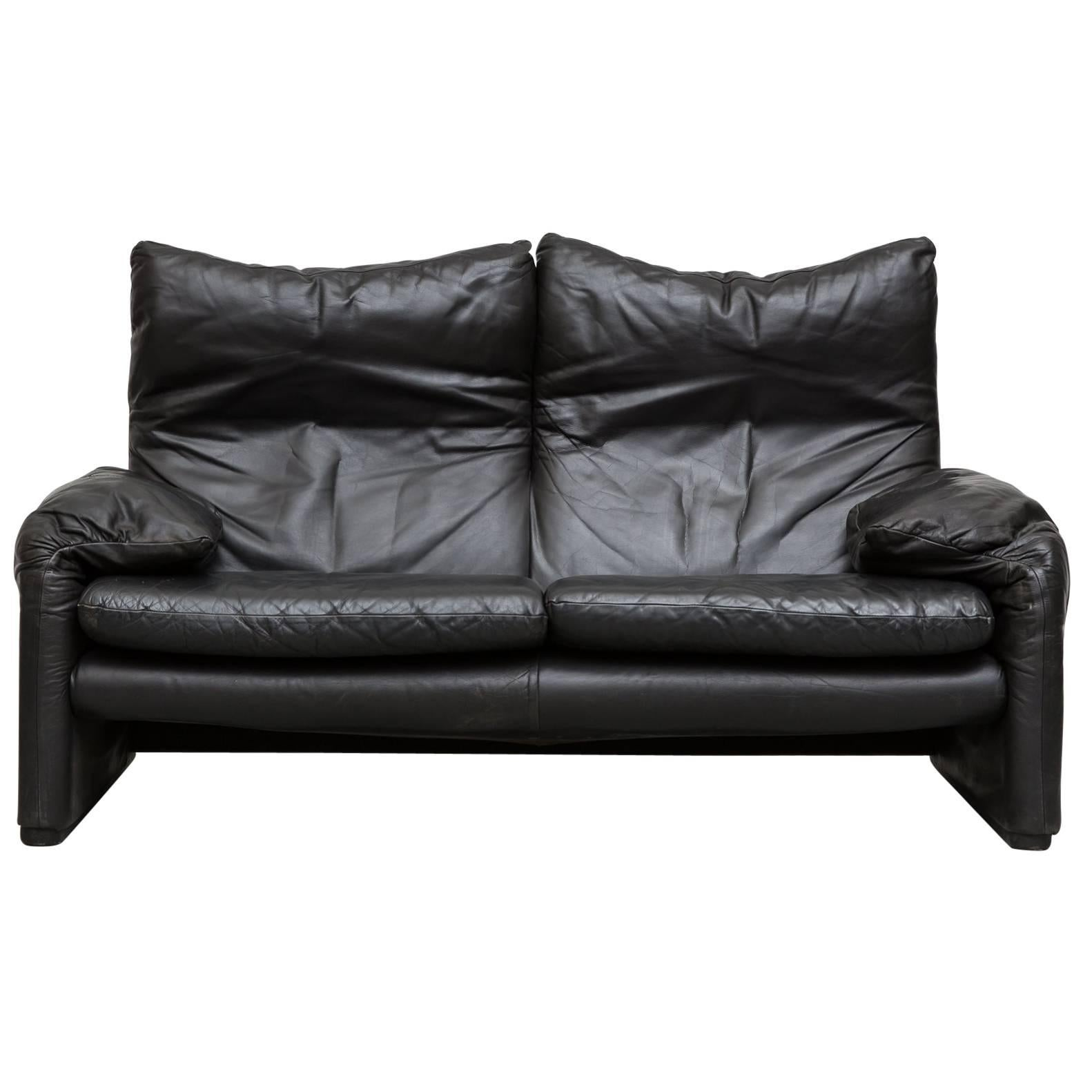 black leather loveseat by vico magistretti