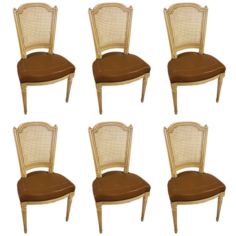 Set of Six French Louis XVI Style Chairs with Leather Seats and Caned Back