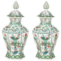 Pair of Famille Verte Facetted Baluster Vases and Covers