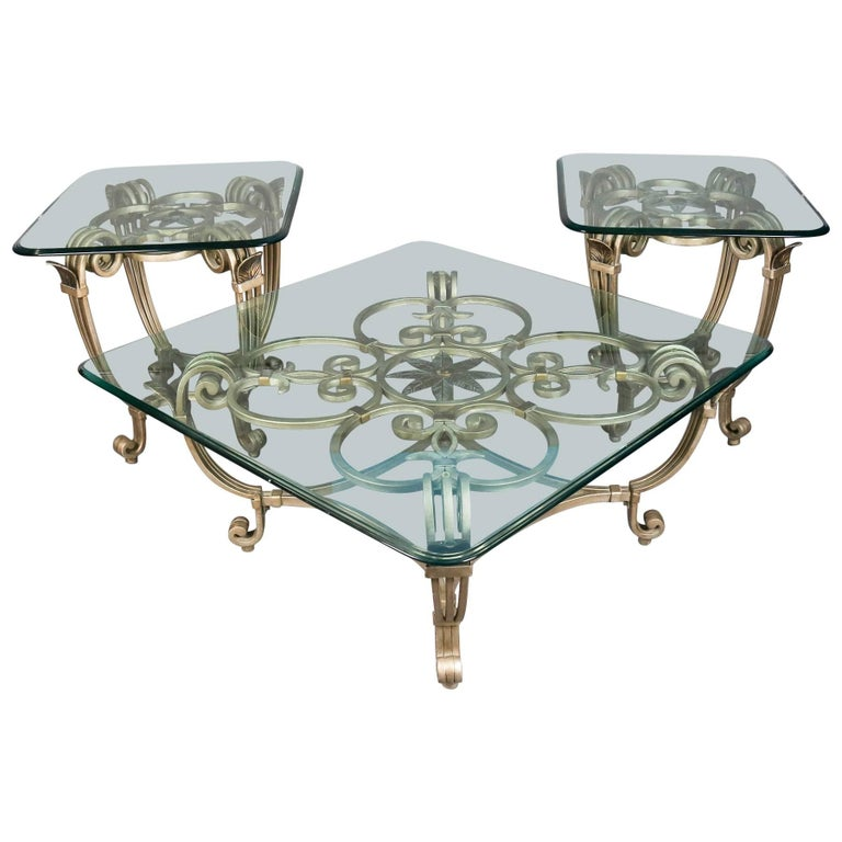 Hollywood regency gilt iron and glass fleur de lis table for Iron coffee table set
