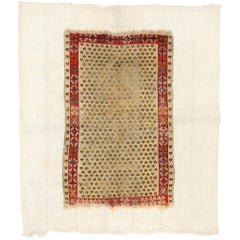 Distressed Antique Ghiordes Rug with Cintamani Pattern