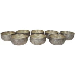 Set of Eight Vintage Burmese Hand-Hammered and Repousse Silver Bowls