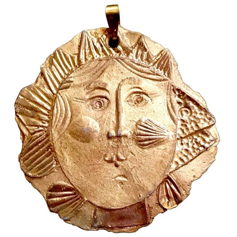 Roger Capron, Gilt Porcelain Medallion For Sale